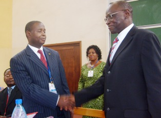 UB's VC shake hands with Bureau Emploi's Germain Salla after signing partnership agreement