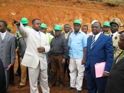NW Regional Delegate of Urban Development, Emmanuel Ayang Asongwed explaining to Minister Motaze the tarring of Upstation GRA R