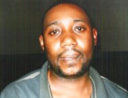Obi Ayuk, quaffing a cold bottle of coke in jail