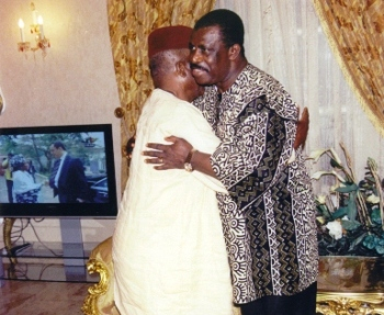 Fru Ndi in embrace with PM Inoni at PM's Lake side residence during condolence visit