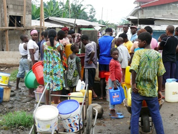 Buea, Cameroon.JPG; water scarcity.JPG; local population wait long hours for the previous liquid to flow
