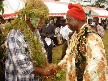 Chief Mbile shake hands with Chief Esoh Itoh, SWECC President