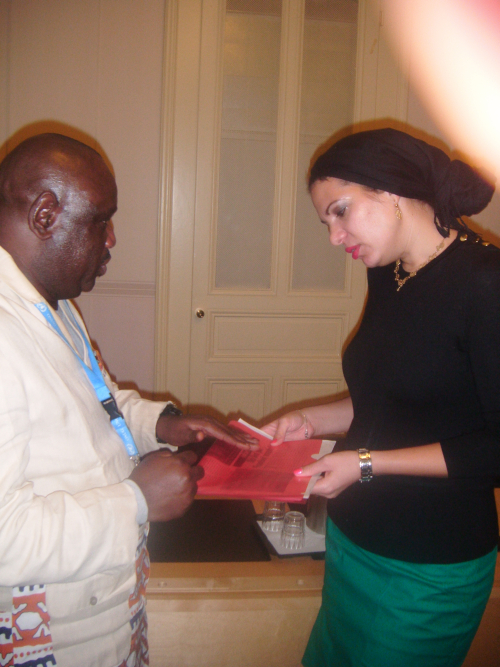 Ngwane Ngwane discussing with Ms Rita Izsak-Ndiaye, UN Special Rapporteur on Minority issues